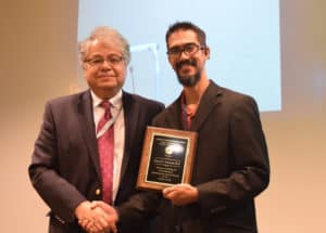Sam Atcherson, Ph.D., (right) professor in the Department of Audiology and Speech Pathology, was awarded the Excellence in Scholarship Award by Reza Hakkak, Ph.D., associate dean for research.