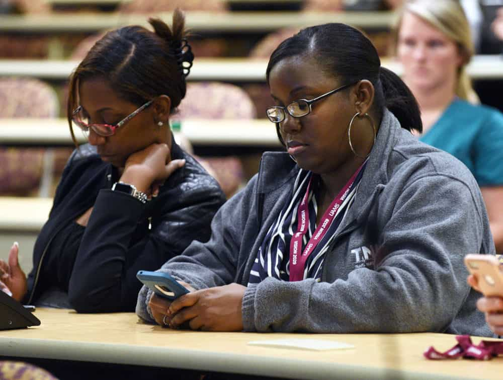 Employees used their cellphones to answer survey questions during the Vision 2029 Town Hall.