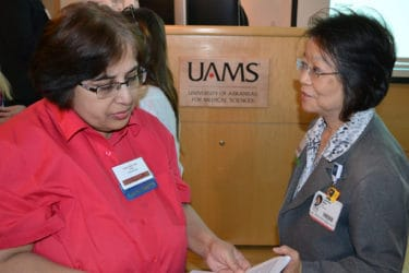Gohar Azhar, M.D., left, confers with Jeanne Wei, M.D., Ph.D.,, between speakers at the Geriatric Update.