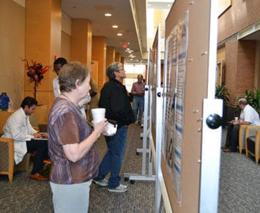 During a conference break, attendees at the Geriatric Update examine some of the 16 research posters on display at the Reynolds Institute.