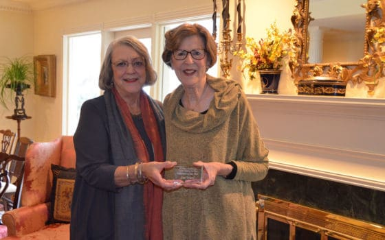 Sue Ward (right), UAMS Winthrop P. Rockefeller Cancer Institute 2018 Volunteersof the Year, with Janie Lowe, director of volunteer services and auxiliary.