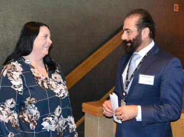 Issam Makhoul, M.D., right, visits with Leigh Ann Wilson before he addresses the audience at the Sickle Cell Symposium. Makhoul is director of the UAMS Adult Sickle Cell Clinical Program.