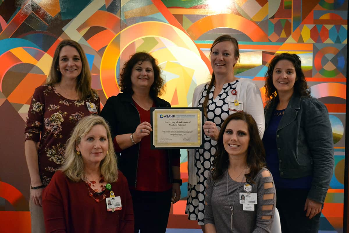 UAMS faculty who worked on the award application include (from left): Kathryn Neill, Pharm.D.; Susan Long, Ed.D.; Wendy Ward, Ph.D.; Amber Teigen, M.M.Sc.; and Lisa Rhoden, M.Ed.