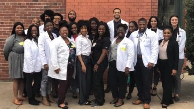 UAMS students visiting KIPP Delta Collegiate High School in Helena to talk about preparing for careers in health care.