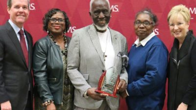 UAMS Chancellor Cam Patterson, M.D., MBA (left), and TRI Director Laura James, M.D. (far right), presented the award to the Rev. William H. Robinson, Deborah Bell and Arlene Williams.