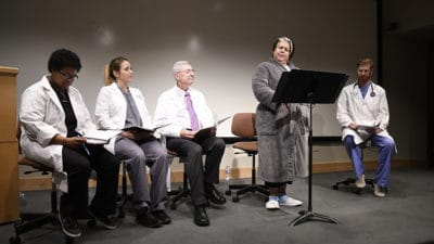 "The cast of ""W;t,"" including Richard Wheeler, M.D., (third from left), tells the story of Vivian Bearing, Ph.D., a 50-year-old professor of 17th century English literature who has been diagnosed with stage four metastatic cancer."