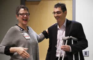Kostas Arnaoutakis, M.D., (right) associate professor in the COM Department of Internal Medicine's Hematology/Oncology division, facilitated the group discussions. He is shown with Mary Cantrell, M.A., executive director of the Centers for Simulation Education.