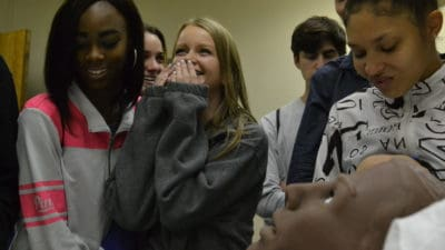 "Students from Little Rock Central High School are surprised when a mannequin at the UAMS Simulation Center provides verbal feedback during their visit for Physiology Understanding (""PhUn"") Day."