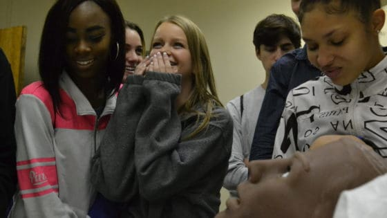 """Students from Little Rock Central High School are surprised when a mannequin at the UAMS Simulation Center provides verbal feedback during their visit for Physiology Understanding (""""PhUn"""") Day."""