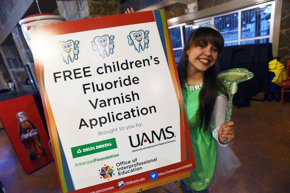 The Delta Dental Tooth Fairy encourages Boo at the Zoo participants to get their free fluoride varnish application.