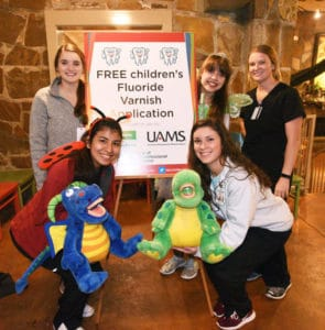 UAMS students used cute puppets to teach Boo at the Zoo attendees about good oral health.