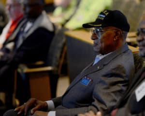 A veteran of Korea watches the presentation after breakfast.