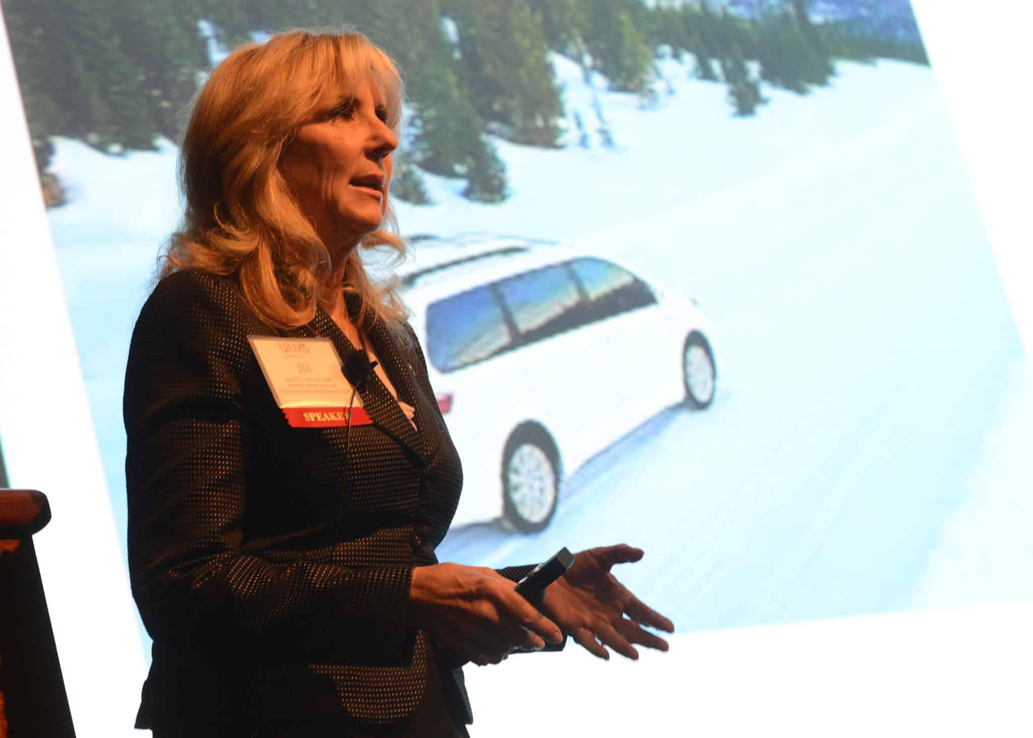 Dr. Berg giving presentation