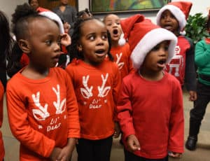 "Head Start students sing ""Jingle Bells"" in the chancellor's office."
