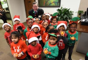 Head Start students after caroling, with oranges given to them by Chancellor Cam Patterson.