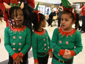 """Elves"" caroling in the hospital's Lobby Cafe."