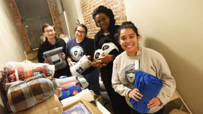 From left: UAMS students Phuong Gip, Rosa Ruvalcaba Serna, Dalith Bessemepseayuk and Thelma Juarez distributing blankets to the homeless at Canvas Community Church.