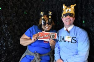 Lots of UAMS employees enjoyed the festive photo booth, including Rhonda M. Smith, R.N., (left) and Chancellor Cam Patterson, M.D., MBA.