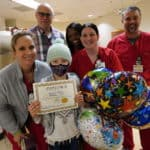 Abigail Lewis (center) celebrates with her health care team at the UAMS Radiation Oncology Center following her final radiation treatment.