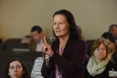 Linda Larson-Prior, Ph.D., asks a question during the conference.