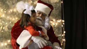 James Pruss as Santa poses with little girl