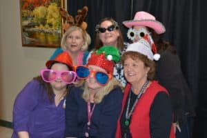 Employees at the Northwest Regional Campus smile for the camera. Employees at the Regional Campuses also enjoyed a festive feast on Dec. 6.