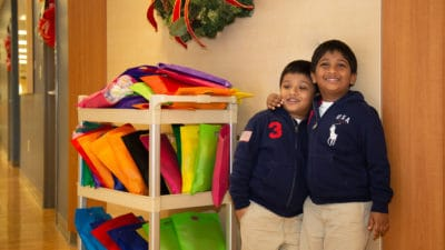 Harshad (L) and Kovidh Salidi return to the NICU every Christmas with presents for the preemies.