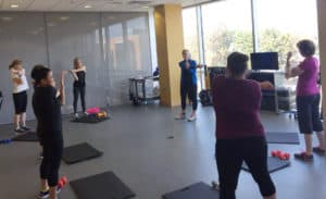 Fitness Center members participate in a total body training class.