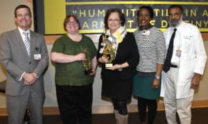 From left: Chancellor Cam Patterson with Unity Award winning team representatives Nia Indelicato, Pam Christie and Monica Smith, and Billy Thomas of the Center for Diversity Affairs.