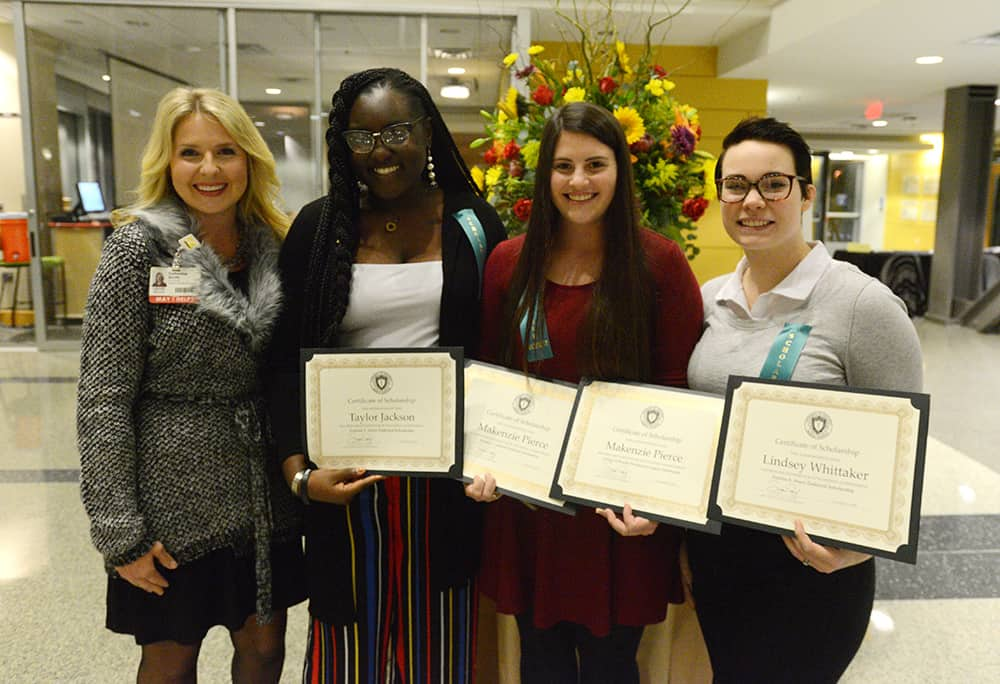 Catherine M. Smith, M.Ed., (left) director of the Cytotechnology program, celebrates with Taylor Jackson, Makenzie Pierce and Lindsey Whittaker on their scholarship awards.