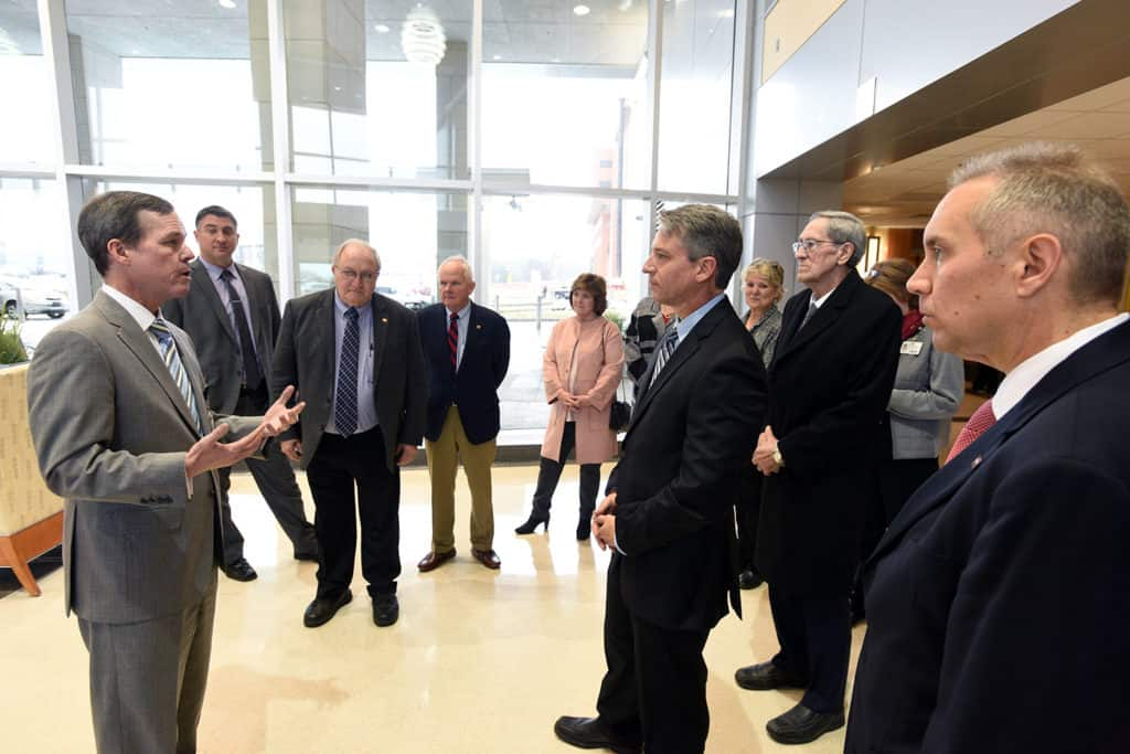 UAMS Chancellor Cam Patterson, M.D., MBA welcomes members of the Arkansas Legislature's Public Health, Welfare and Labor Committee for a tour of the campus.