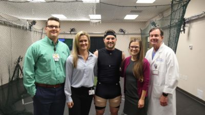 Members of the research team in the lab with pro golfer Austin Cook (center) and UAMS Orthopaedc Surgery chair Lowry Barnes, M.D.