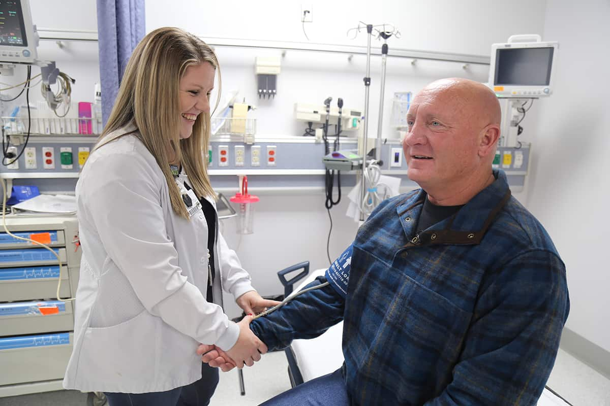 Donny Koger, left, has his blood pressure checked by Olivia Bayne, RN, during a visit to Mena Regional Health System hospital