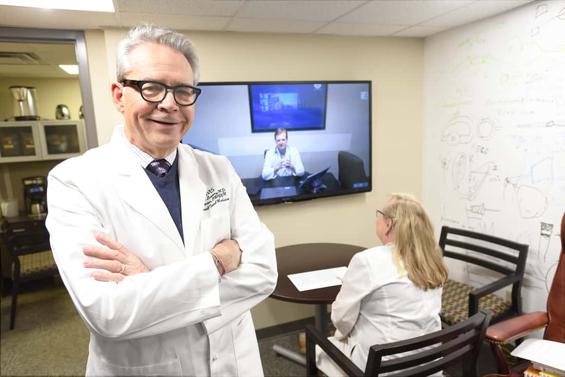 Curtis Lowery, M.D., left, pauses during a live video conference. Lowery founded the AR SAVES program, which has been named one of three national finalists for the Hearst Health Prize.