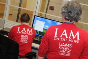 "UAMS staff wore long-sleeved T-shirts with ""I AM on the Move"" as they helped transport patients from the old hospital to the new one. The move took two days."