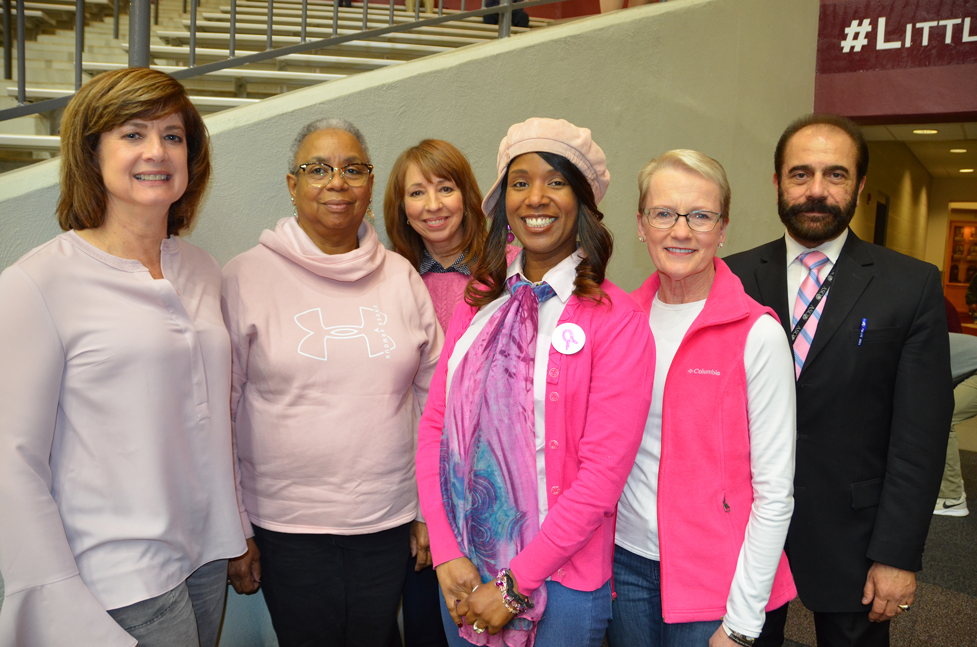 Honorees at the UALR Trojans women's basketball Pink Game were (left to right) Liz Caldwell, Donna Boxley, Laurie Shell, Abby Ellington, Terri Seiter and Issam Makhoul, M.D.