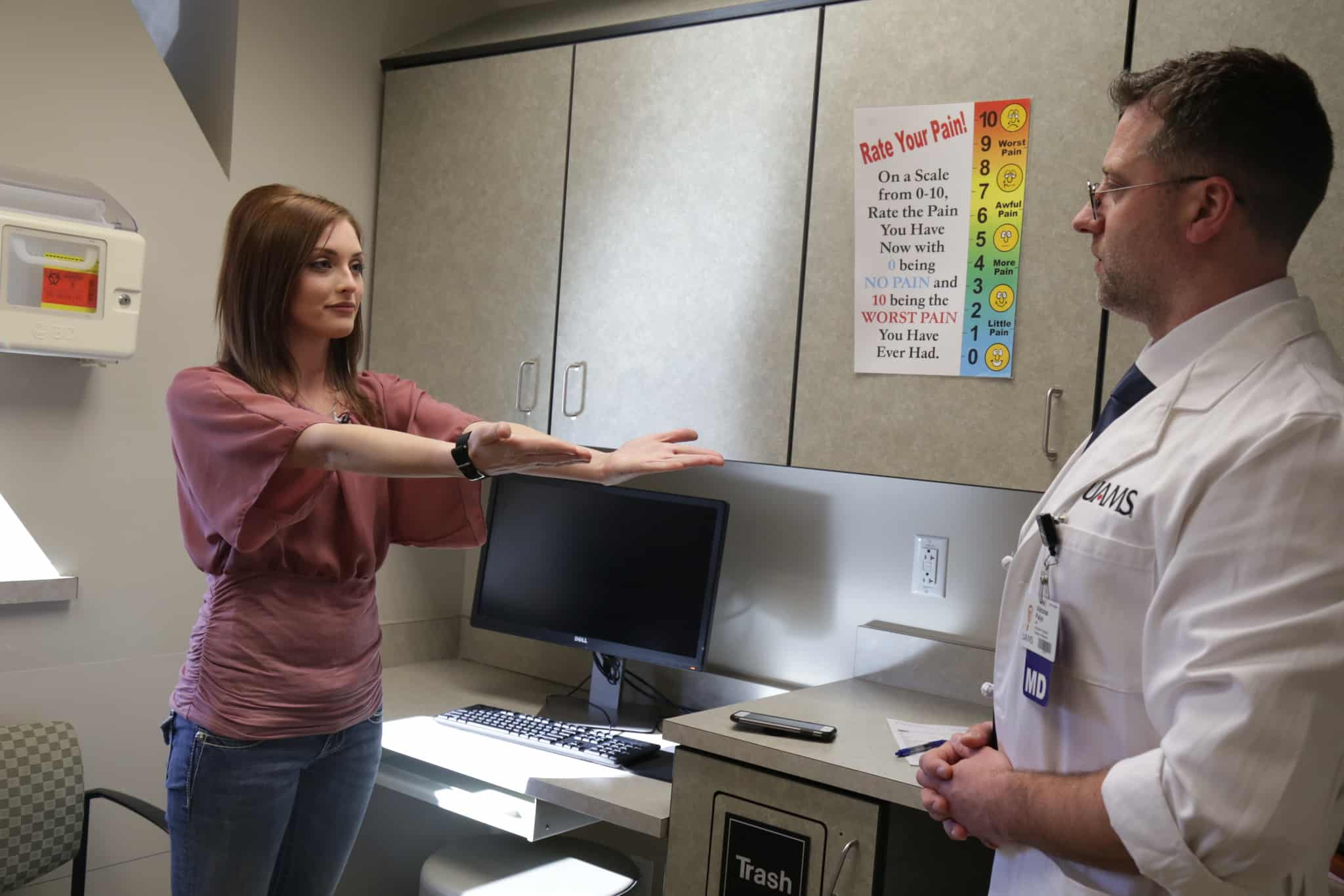 Viktoras Palys, M.D. examines his patient Tori Hatcher weeks after she receives a surgical implant to reduce seizures.
