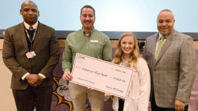 Emily McKinney, president of the Physician Assistant Studies Class of 2019, presents a check for $12,167.96 to Nick Bradford (second from left) from the Arkansas Food Bank during a Jan. 31 ceremony. The funds were raised during the PA students' Heroes Against Hunger 5K. They are joined by Edward Williams, MPAS, chair of the Department of Physician Assistant Studies and director of the PA program, and William Greenfield, M.D., from the Arkansas Medical, Dental & Pharmaceutical Association.
