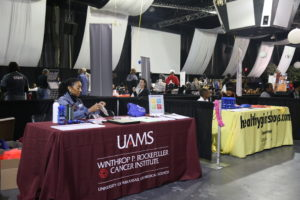 Karen Crowell, M.D., a physician educator for health initiatives and disparities, awaits visitors to the UAMS booth during the early hours of the Midsouth Black Expo.