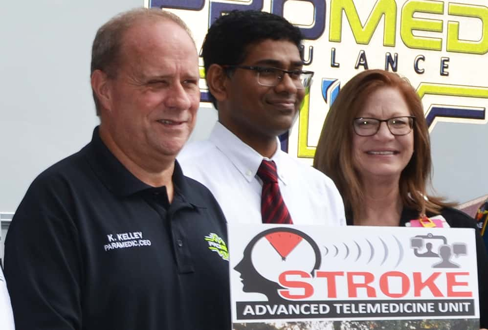 Renee Joiner, AR SAVES director, right, Sanjeeva Reddy Onteddu, M.D., AR SAVES medical director, and Ken Kelly, CEO of ProMed ambulance company in El Dorado, stand in October in front of Medical Center of South Arkansas, an AR SAVES network site.