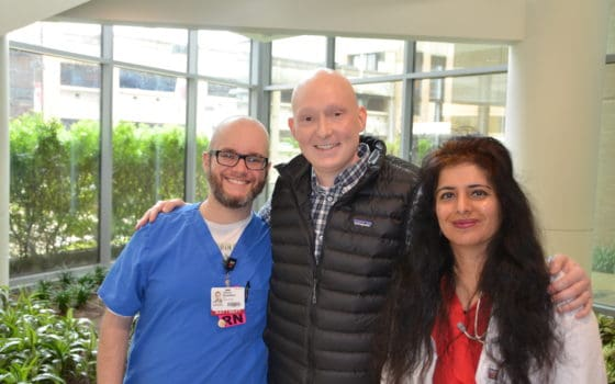 Third-year UAMS College of Medicine student and cancer survivor Corbin Norton (center) with his medical oncologist Rashmi Verma, M.D., (right) and nurse Jason Guenther, R.N.