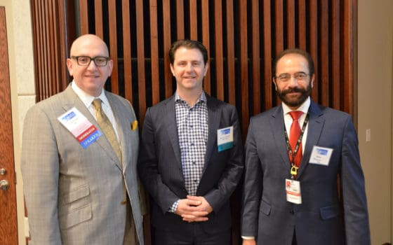 Rasco Symposium course director A. Mazin Safar, M.D., (left) pauses a moment with keynote speaker Ryan B. Corcoran, M.D., Ph.D., (center) and Issam Makhoul, M.D., director of the UAMS Divisions of Medical Oncology and Hematology, during the event.