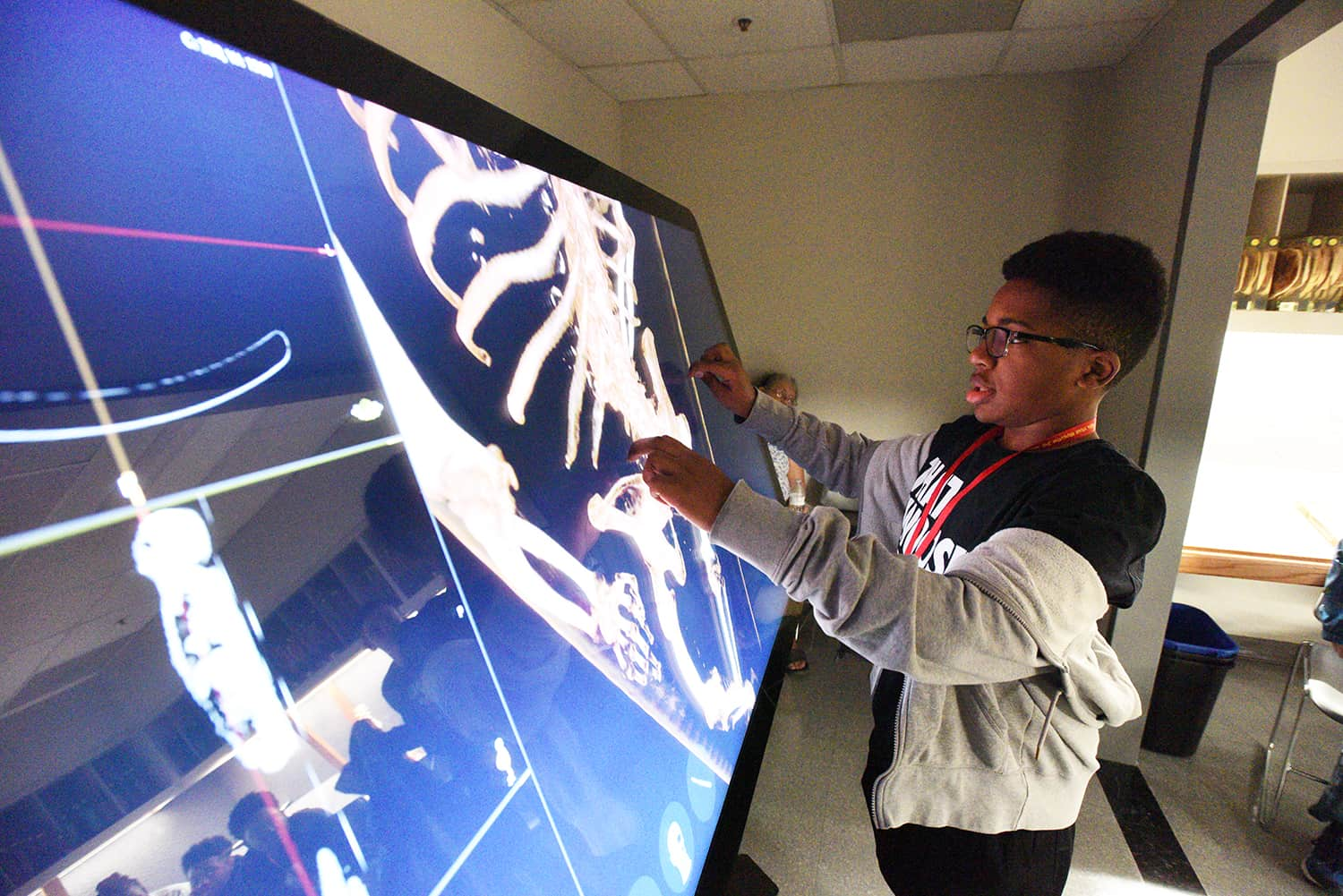 Visiting students learn about skeletal structure during STEAM Revolution at UAMS.