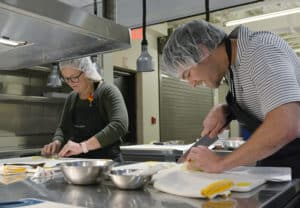 Students from the UAMS Northwest Regional Campus prepare dishes based on the Mediterranean Diet.