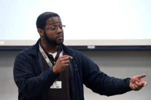 Nick Pettus, senior diversity specialist with the Center for Diversity Affairs, addresses a group of visiting students during STEAM Revolution.