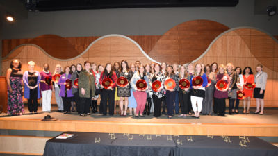 The 2019 UAMS Phenomenal Women on stage with their awards following the event.
