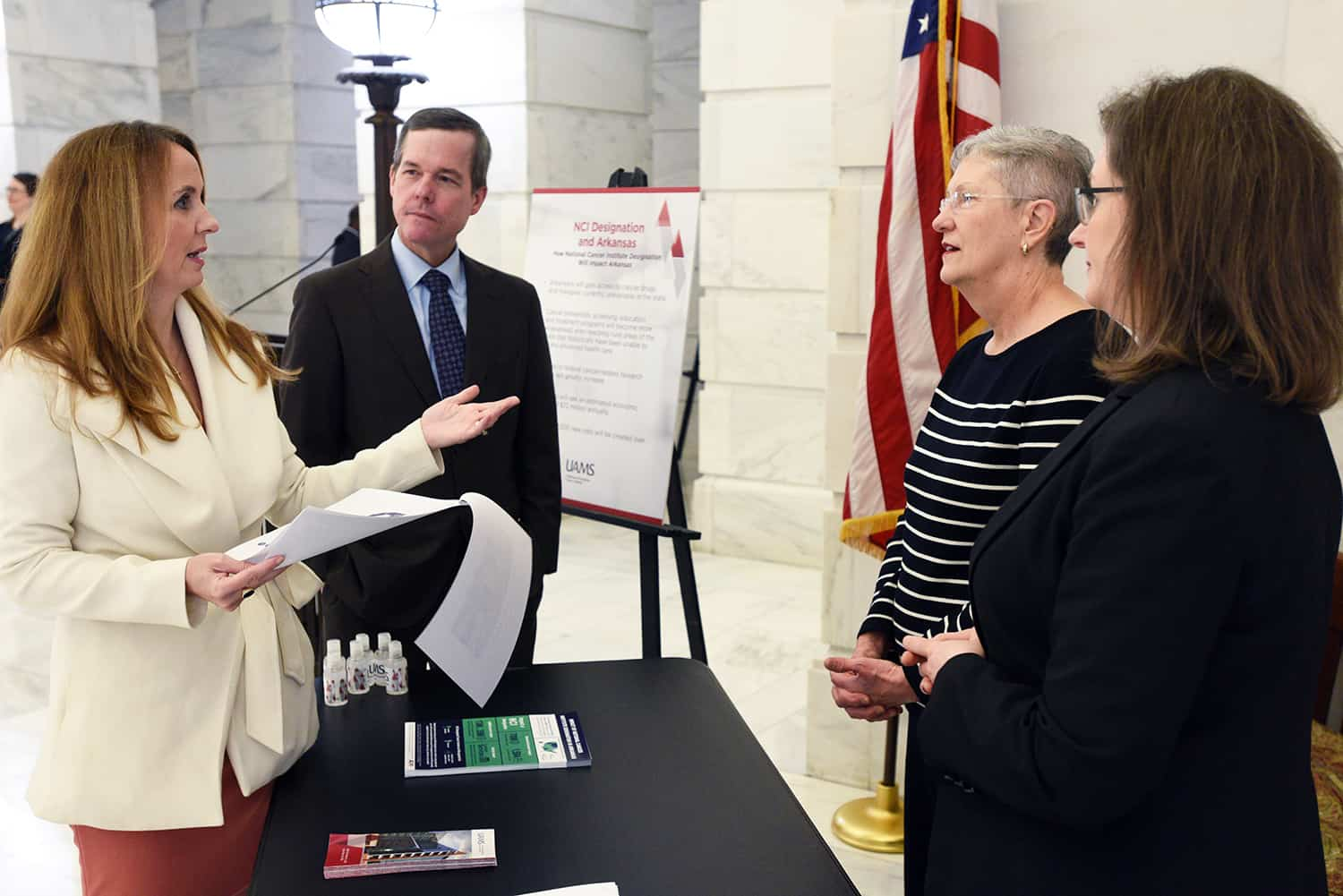 Arkansas Sen. Missy Irvin of Mountain View (left) visits with UAMS Chancellor Cam Patterson, M.D., MBA; Cancer Institute Interim Director Laura Hutchins, M.D.; and Dorothy Graves, Ph.D., Cancer Institute associate director of administration, during UAMS Day at the Capitol.