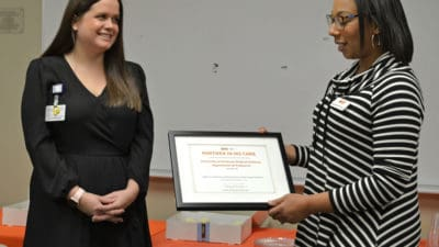 Dr. Willis receiving plaque