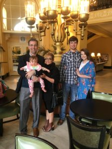 grandaughter, stands next to his wife Claudia, their son-in-law Dakota and daughter Bailey.