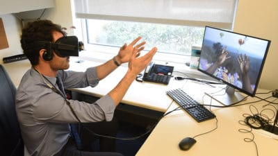 Using virtual reality technology, Nathan King experiences a simulation of vision and hearing loss.